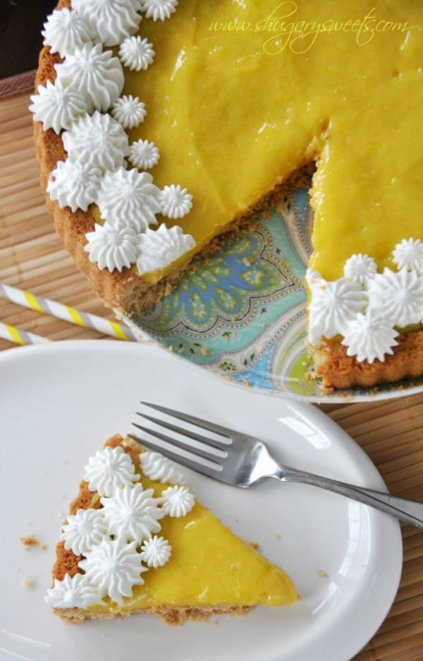 Lemon Tart with Macadamia Nut Crust: shortbread macadamia nut crust topped with homemade lemon curd and whipped cream #lemontart #dessert www.shugarysweets.com