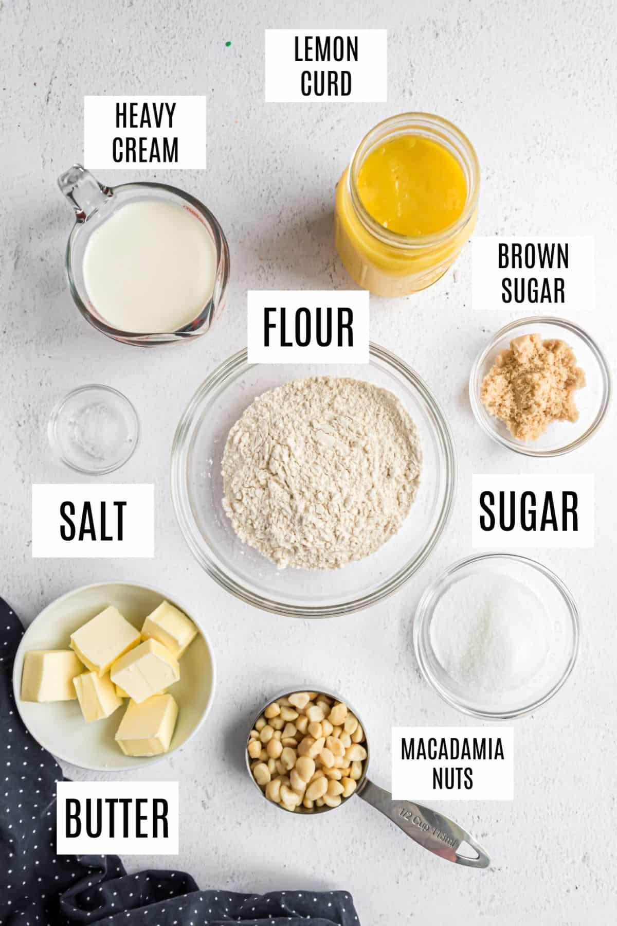 Lemon tart ingredients in small individual bowls.