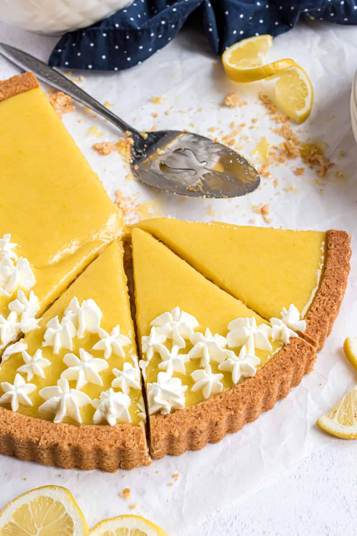 Sliced lemon tart with a golden crust.