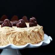 Peanut Butter Cake: moist peanut butter cake with Reese's hearts topped with a creamy PB frosting @roxanagreengirl #peanutbutter