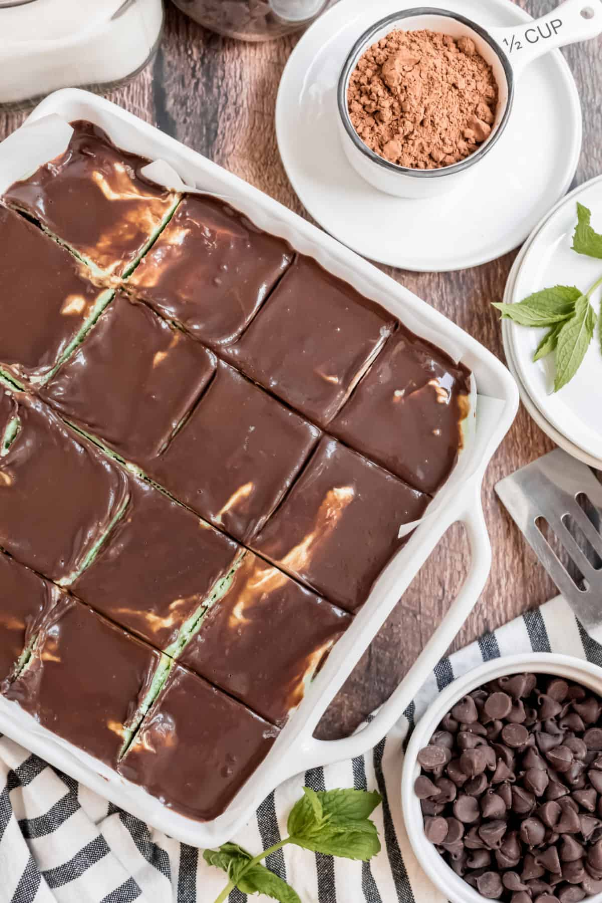 White baking dish with chocolate mint brownies sliced and ready to serve.