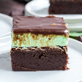Slice of chocolate brownies with mint filling and chocolate ganache.