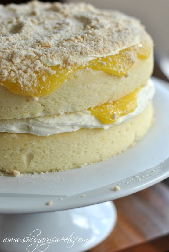 Homemade Lemon Cake with a layer of creamy lemon frosting and fresh lemon curd #cakerecipe #lemon @shugarysweets
