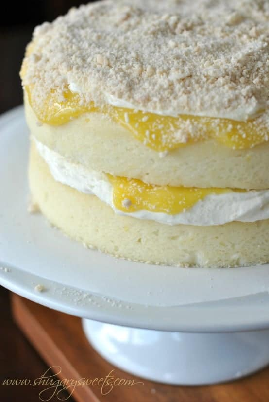 Lemon Cake with a layer of creamy lemon frosting and fresh lemon ...