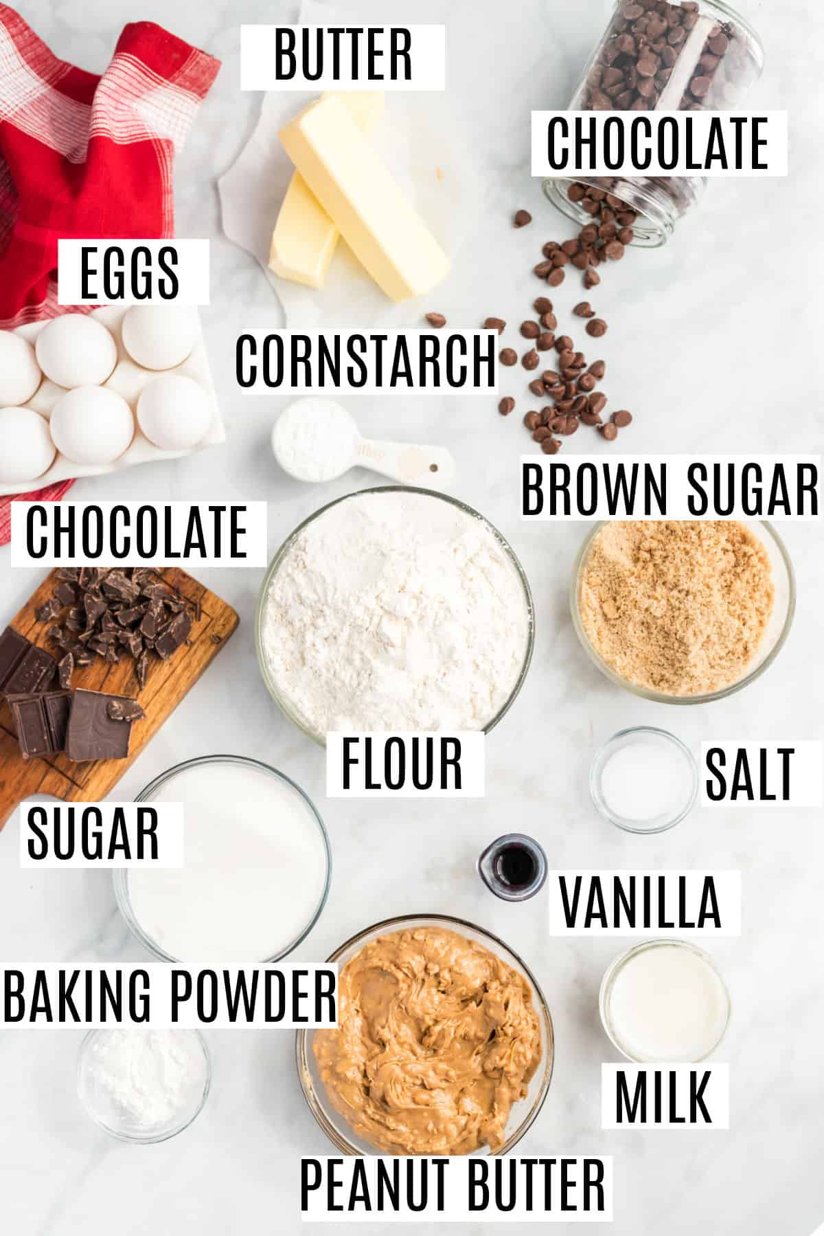 Ingredients needed to make peanut butter chocolate chip cookies from scratch.