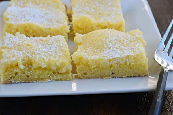 Plate of gooey lemon cake bar
