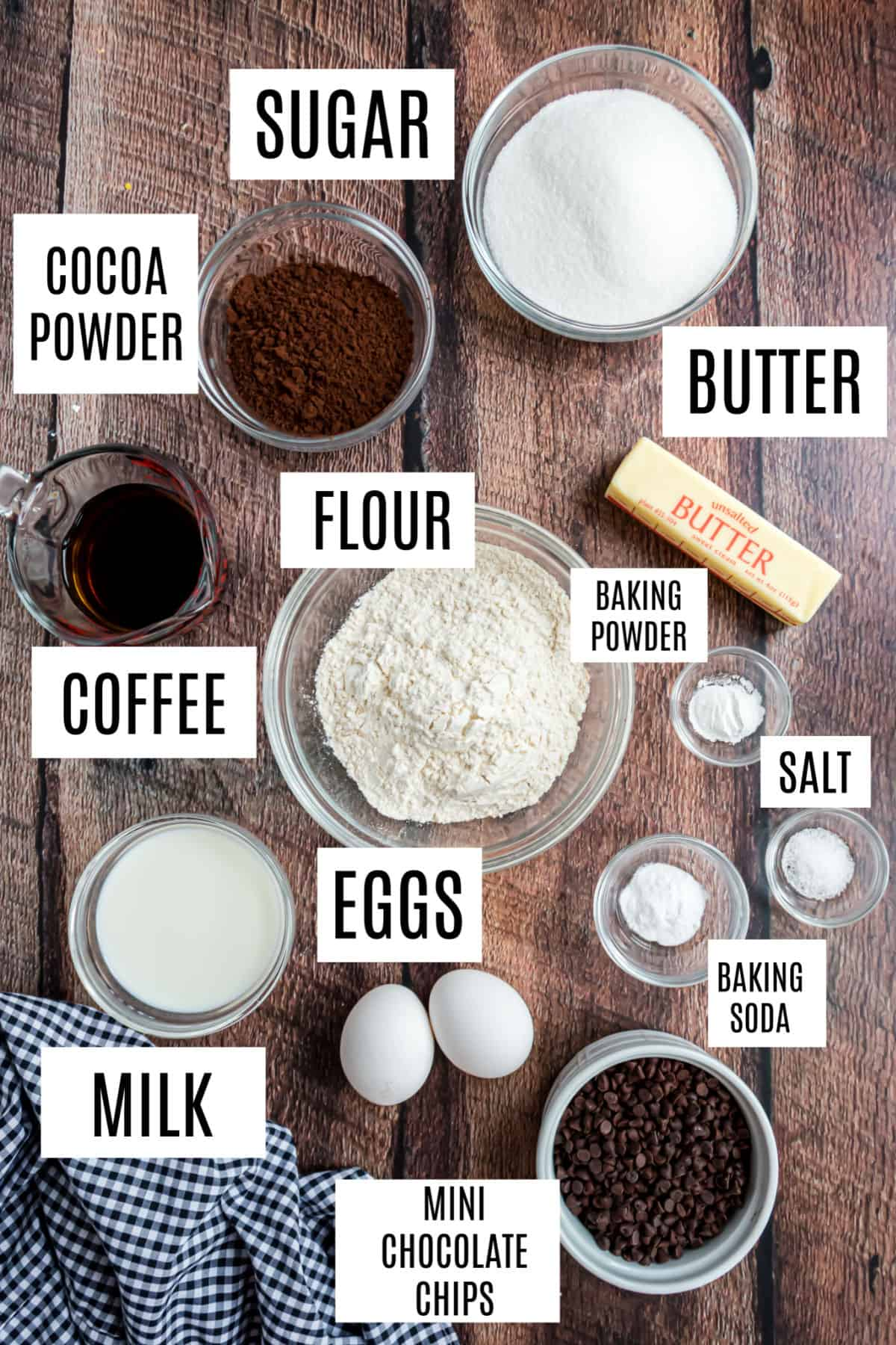 Ingredients needed to make dark chocolate cake from scratch.