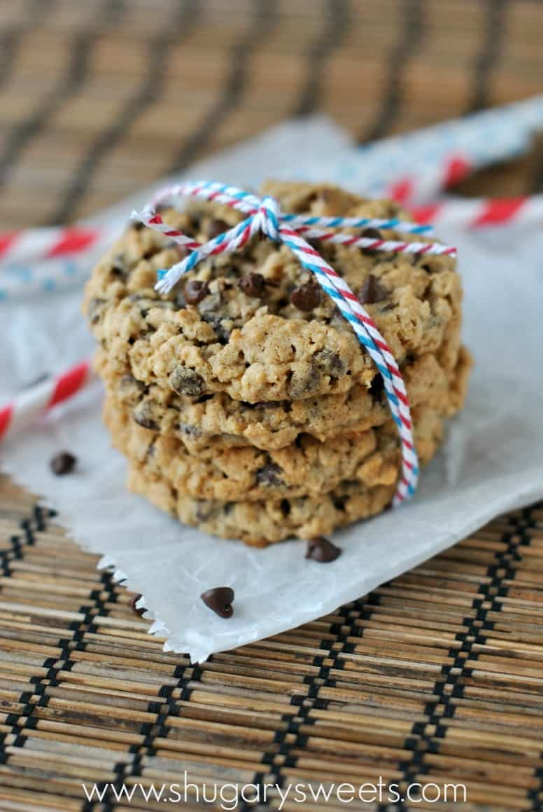 Oatmeal Chocolate Chip cookies on a piece of white parchment paper wrapped in red,white, and blue twine.