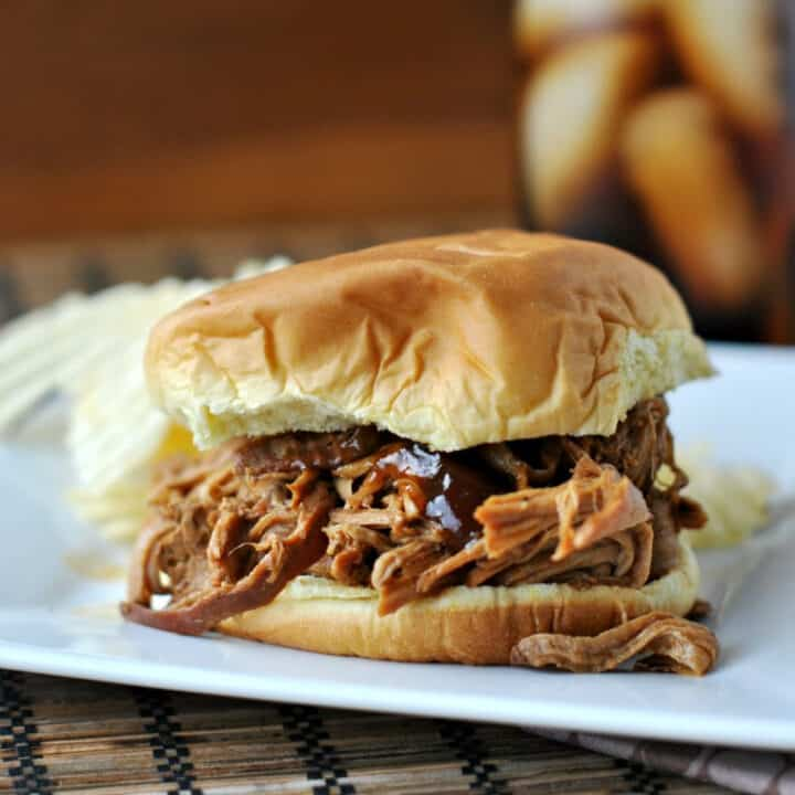 A slow cooker and a handful of ingredients are all you need to make Root Beer Pulled Pork. This tender fall-apart pork is begging to be piled onto buns and served with coleslaw! You'll love this flavorful BBQ inspired meal.