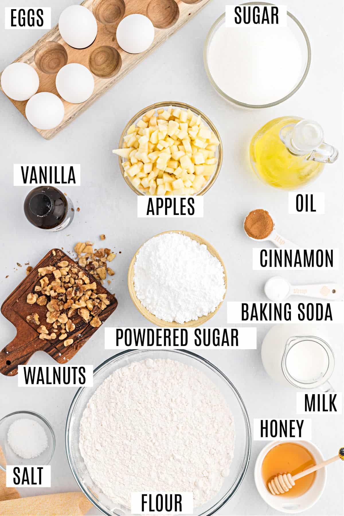 Ingredients needed to make honey apple cake recipe.