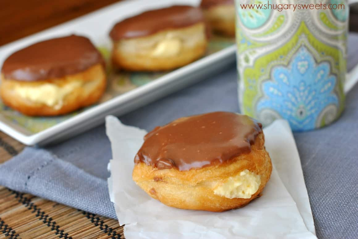 Boston Cream Donuts on a piece of parchment paper.