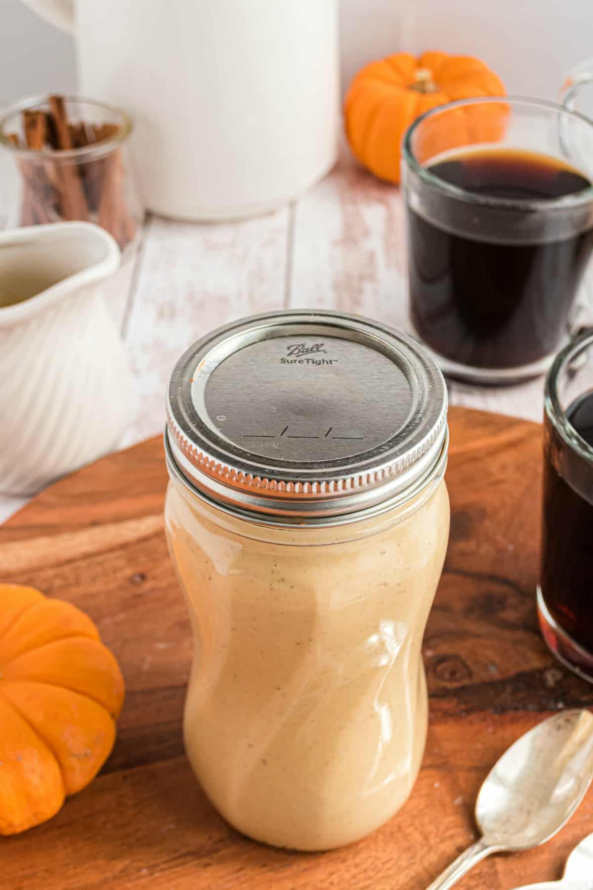 Mason jar filled with pumpkin spice creamer.