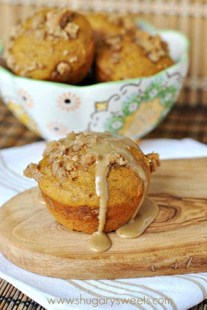 Pumpkin muffin with maple glaze on a wooden board.