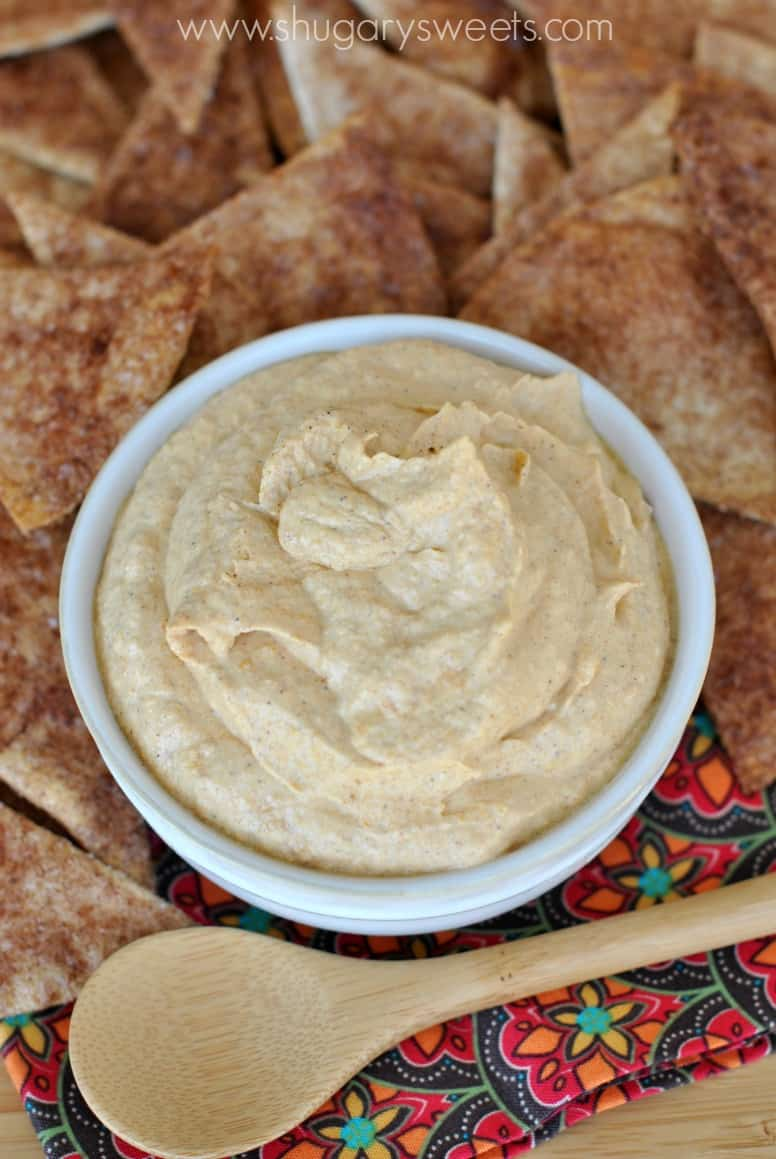 Pumpkin pie dip in a white bowl with cinnamon chips for dipping.