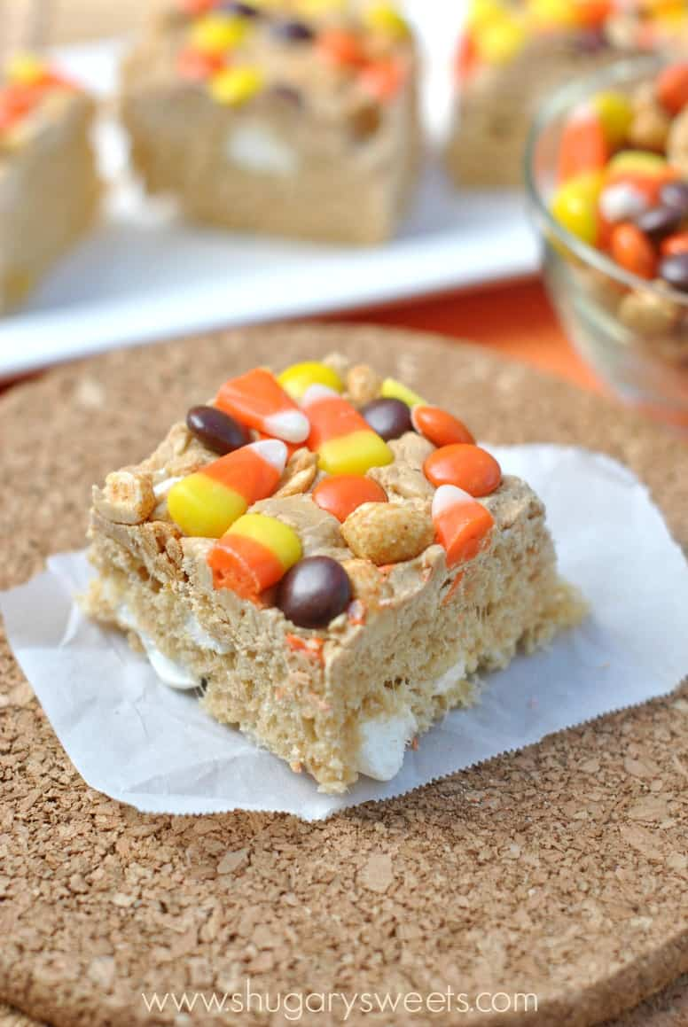 Peanut Butter Krispie Treats cut into a square and topped with M&M's, candy corn, and peanuts.