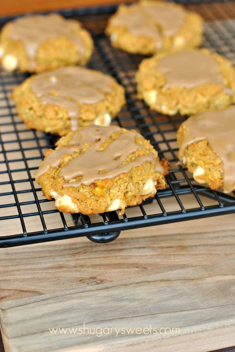 WIre rack with pumpkin cookies topped with maple glaze.