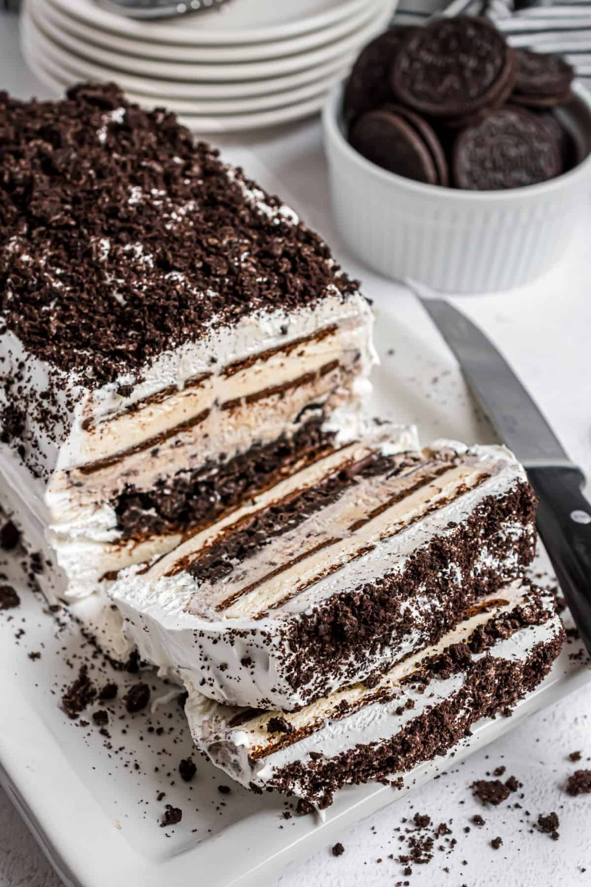 Oreo ice cream cake with slices made so you can see the filling.