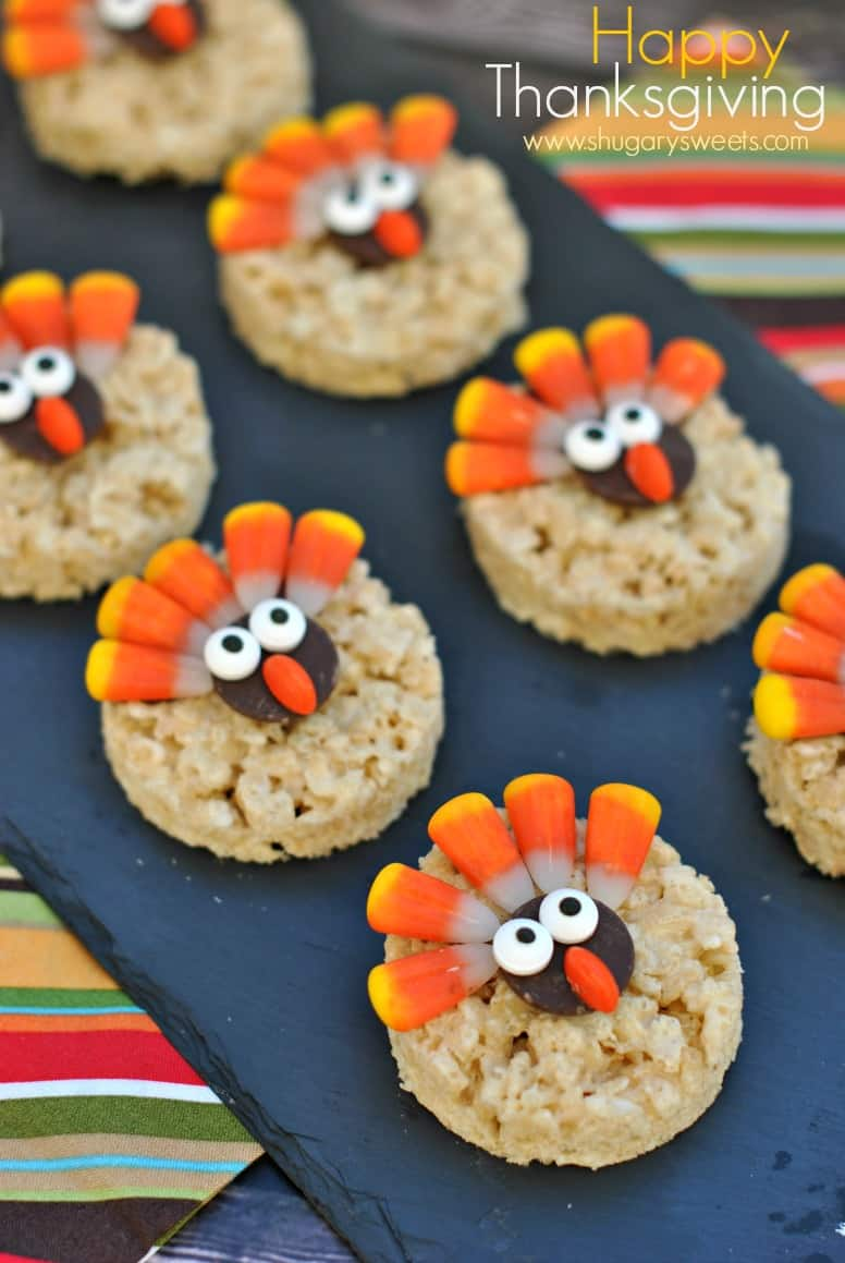 Thanksgiving rice krispie treats cut into circles and decorated to look like turkeys.