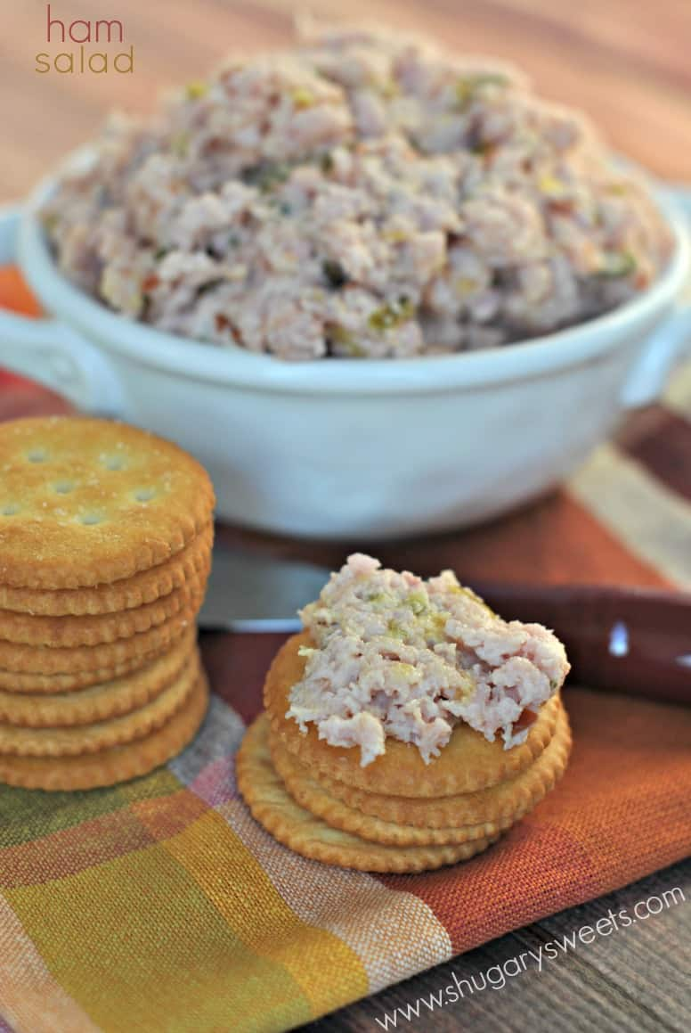 Ham salad in a white bowl served on a stack of ritz crackers.