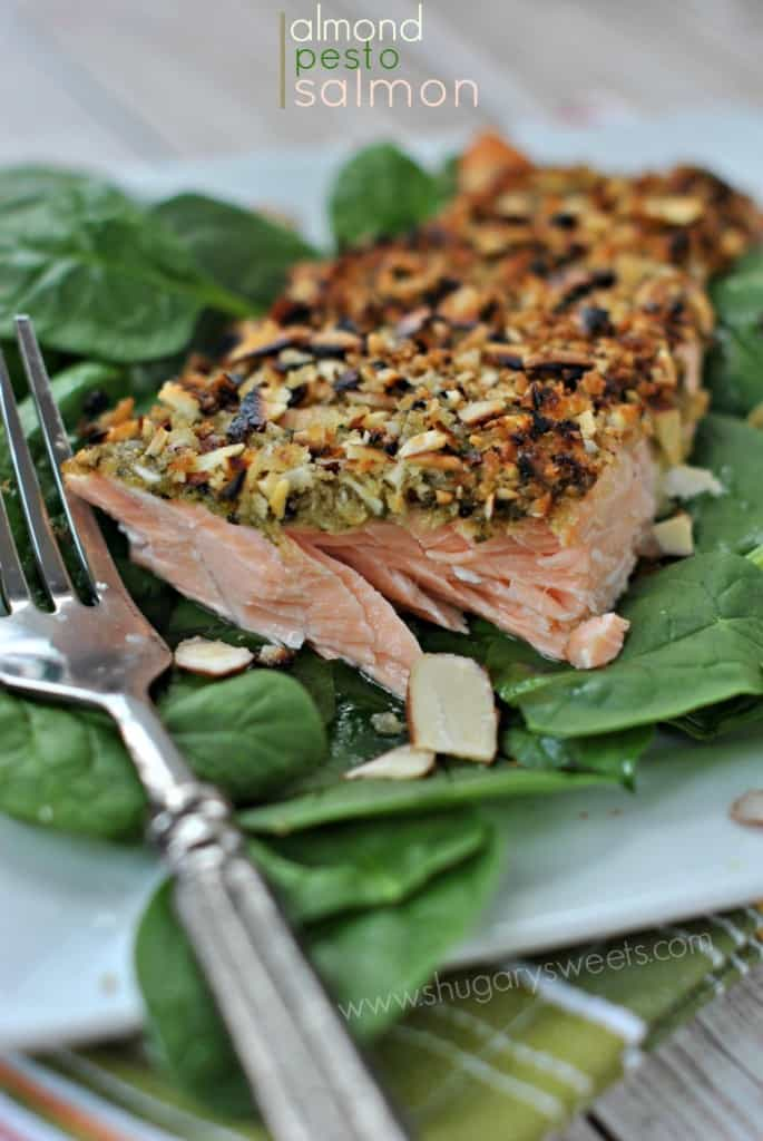 Baked Salmon with Almonds and Pesto on bed of spinach