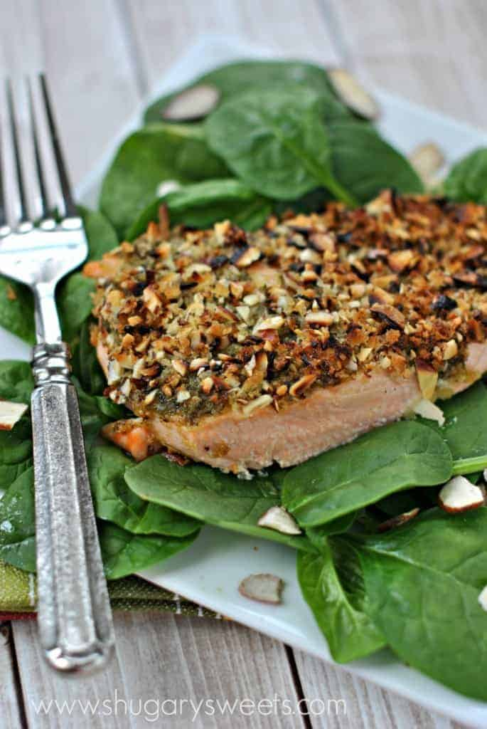 Flaky baked salmon recipe with basil pesto and almonds. So easy and delicious! #thinkfisher