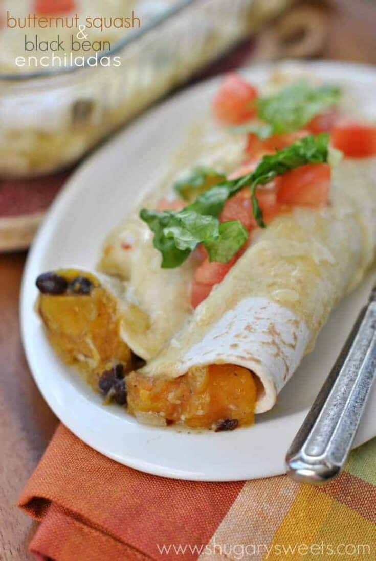 Looking for a meatless dinner idea that doesn't leave you hungry? These Butternut Squash and Black Bean Enchiladas are your answer for a delicious, filling weeknight dinner idea!