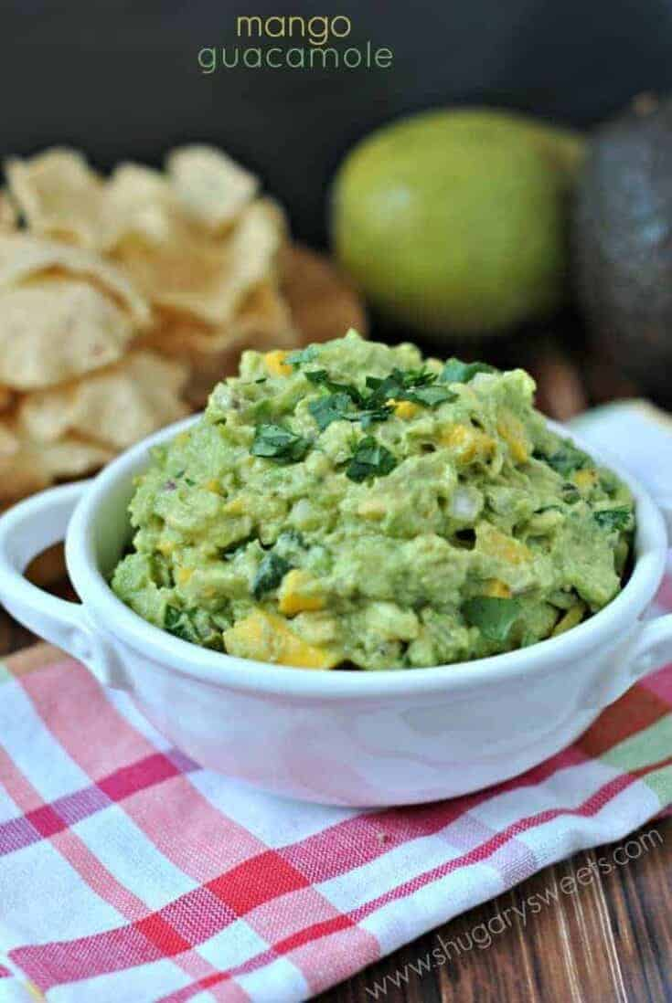 Mango Guacamole is a delicious tex mex snack you didn't even know you were missing in your life! Packed with flavor!