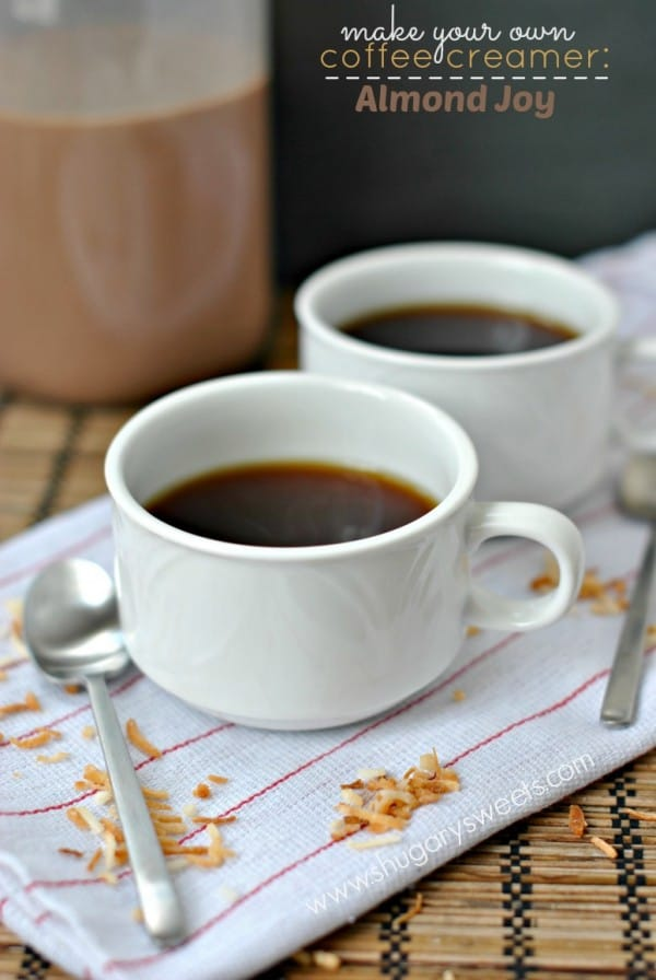 Two cups of black coffee with homemade almond joy creamer in a jar.