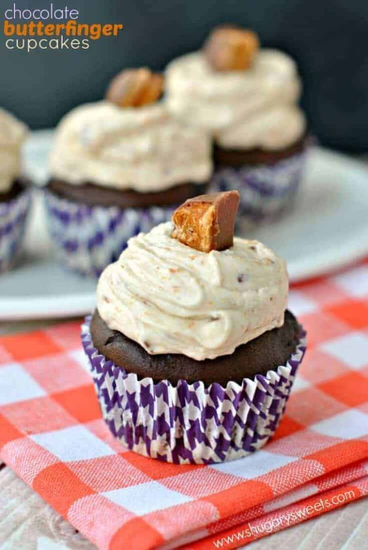 Rich Chocolate Cupcakes are topped with a sweet buttercream frosting filled with peanut butter and Butterfinger candy! These will be the first to go at your next bake sale or pot luck!