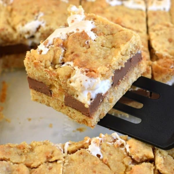 S'mores Cookie Bars are soft and chewy treats packed with graham crackers, marshmallow, and chocolate! These S'mores Bars are easy and delicious!