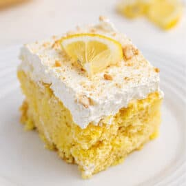 Slice of lemon cake with lemon curd and cool whip.