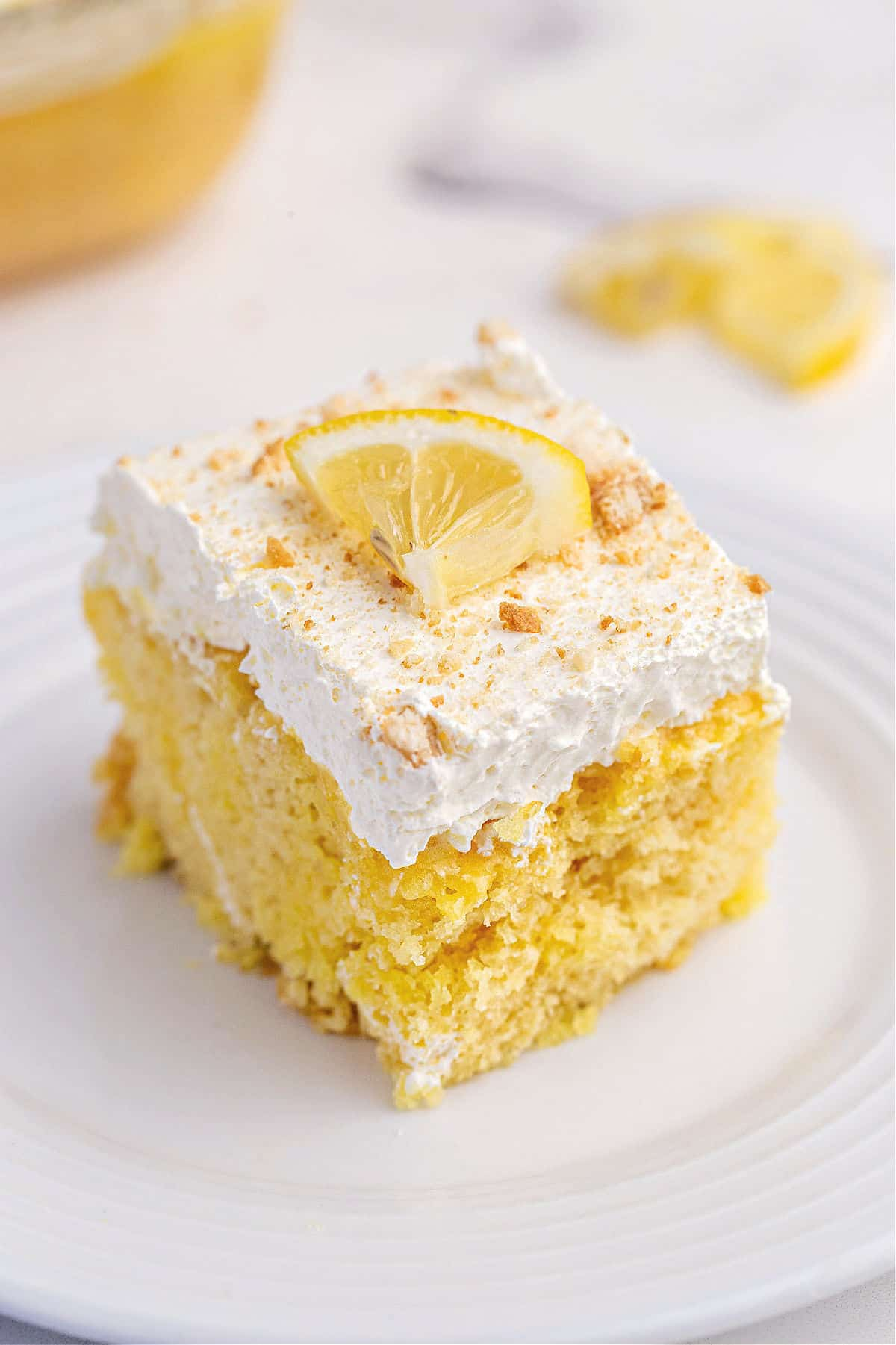Lemon cake topped with lemon gelatin, cool whip, and nilla wafer crumbs.