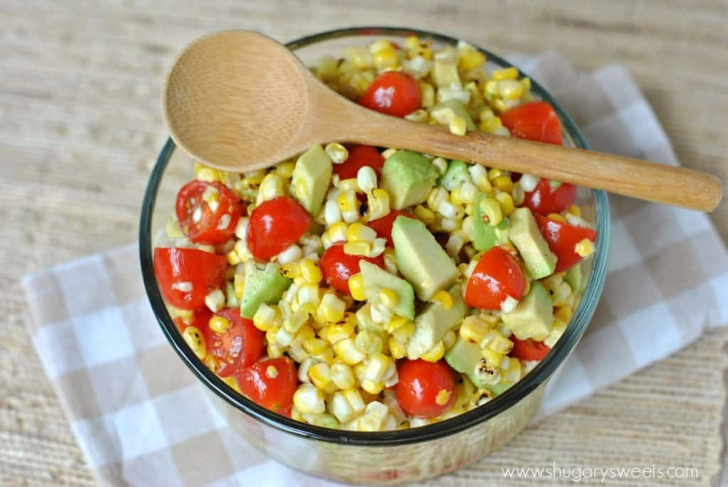 Roasted Corn Salad with Honey Lime Dressing, tomatoes and avocado! A new favorite!