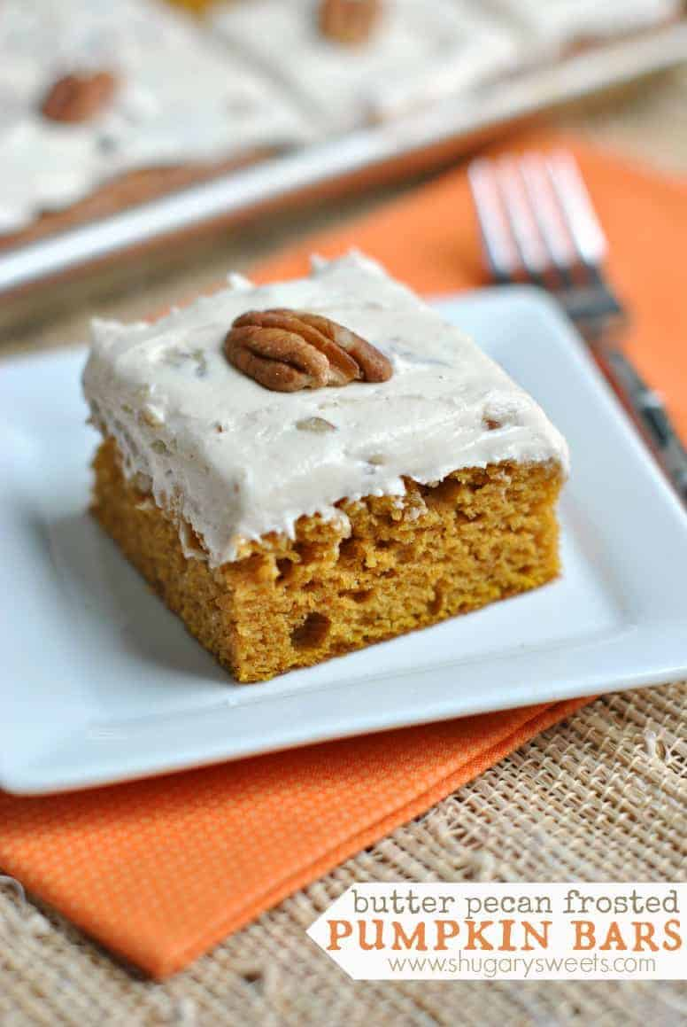 Pumpkin bar with butter pecan frosting and pecan on top.