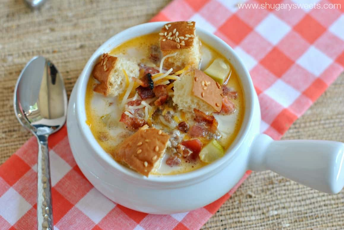 Cheeseburger soup with bacon, croutons, and pickles.
