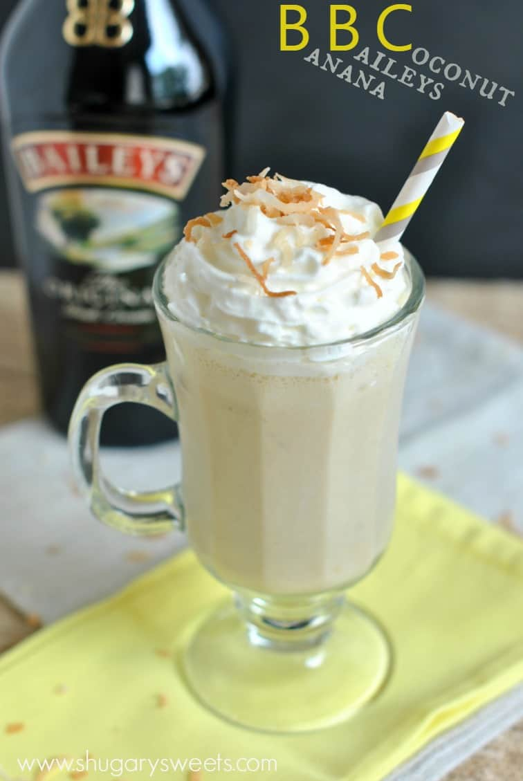 BBC drink in a mug with toasted coconut and whipped cream.