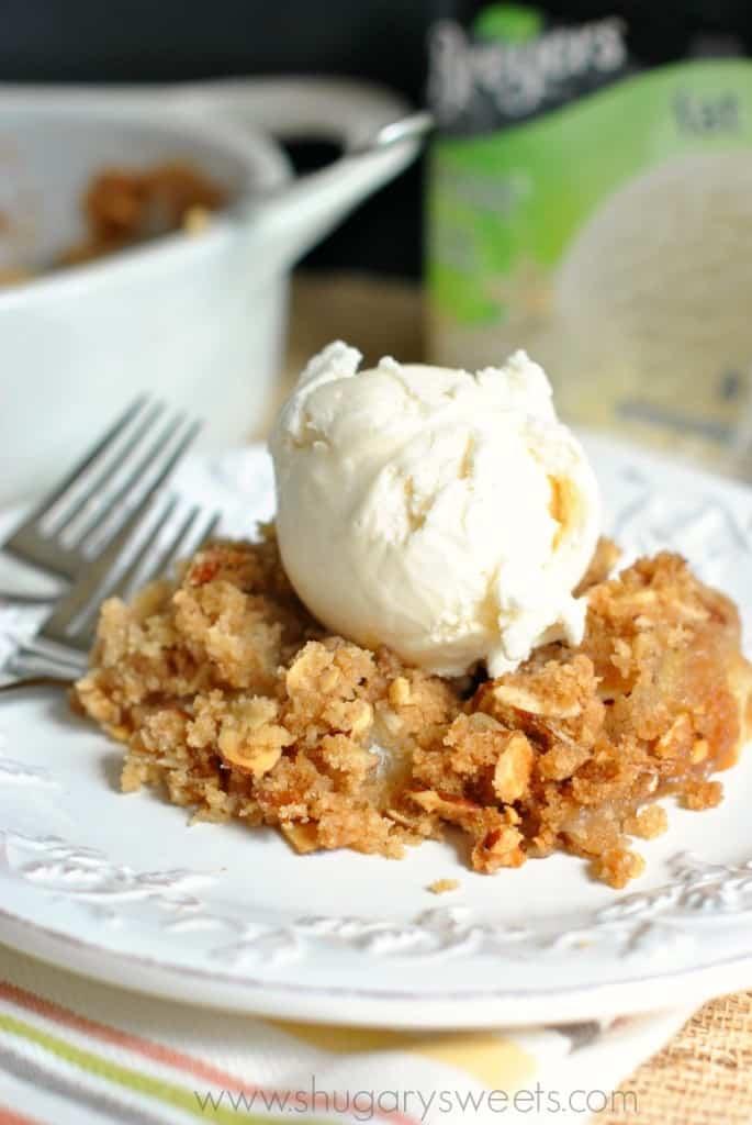 Peach Crisp topped with vanilla ice cream. A delicious, fresh dessert recipe!