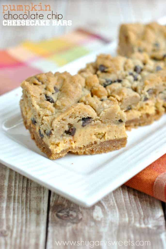 Pumpkin Chocolate Chip Cheesecake Bars on a white plate.