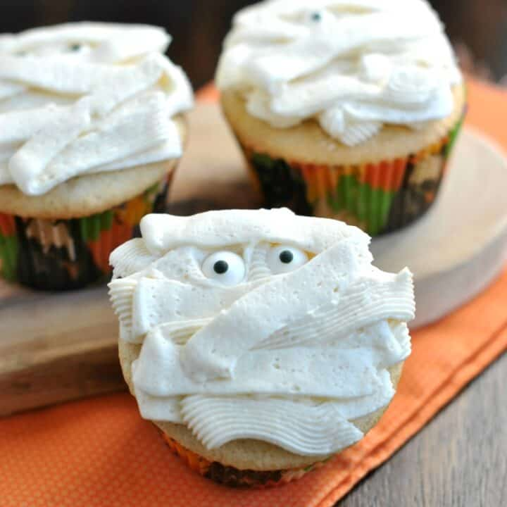 Vanilla bean cupcakes with vanilla frosting decorated for Halloween.