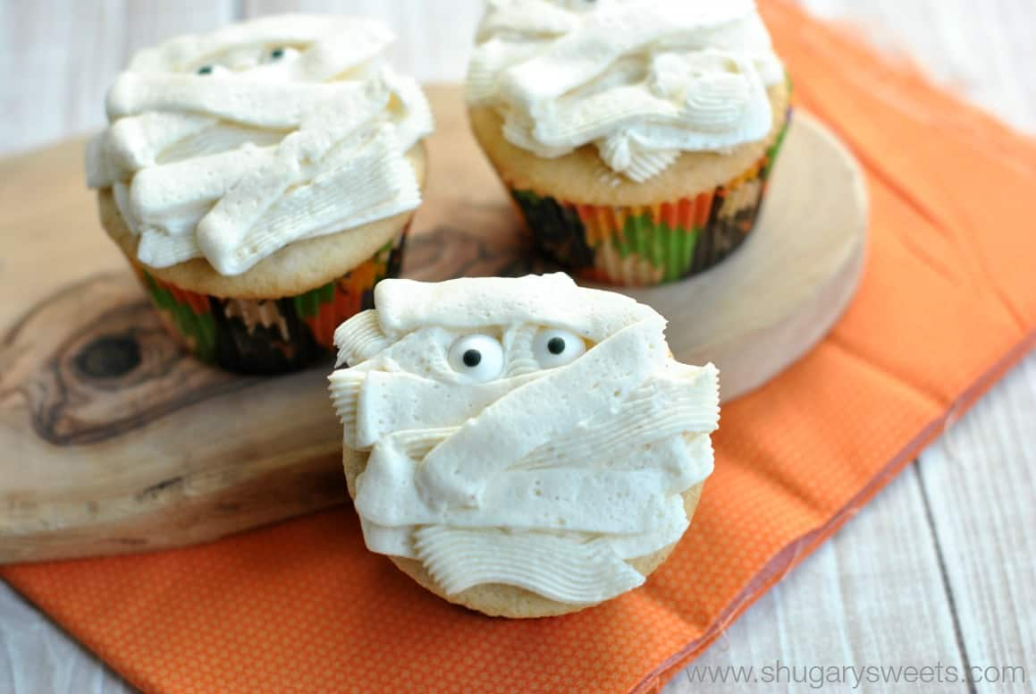 Vanilla cupcakes frosted to look like mummies for Halloween.