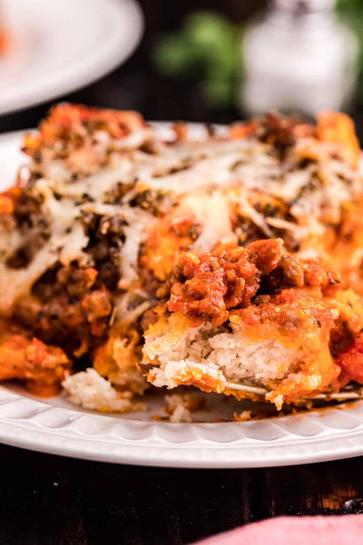 Pizza casserole close up on a plate.
