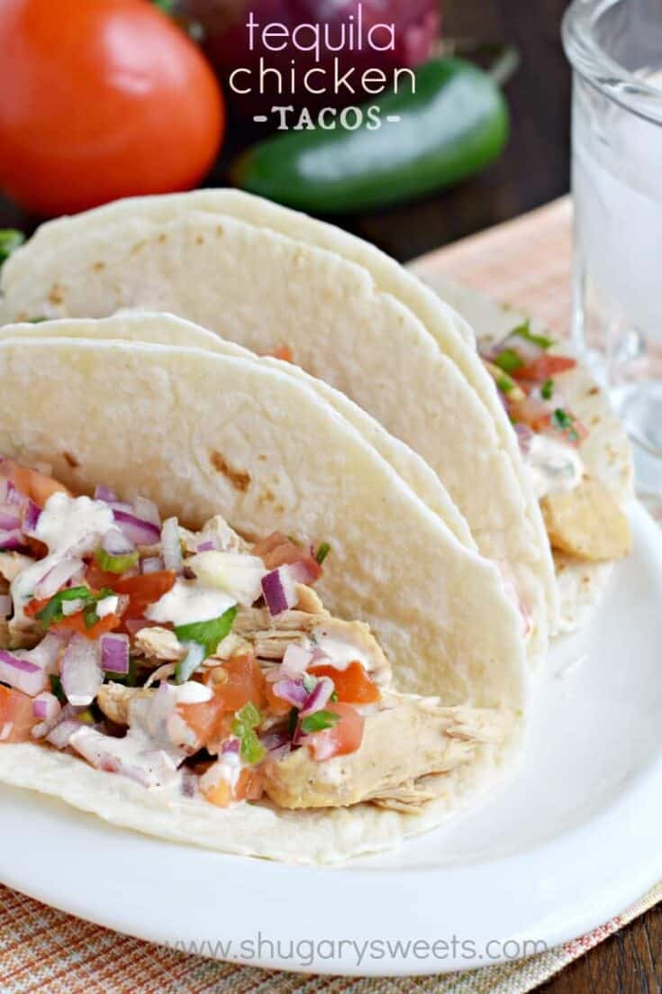 Easy, slow cooker Tequila Chicken Tacos with a fresh pico de gallo and jalapeno cream topping!