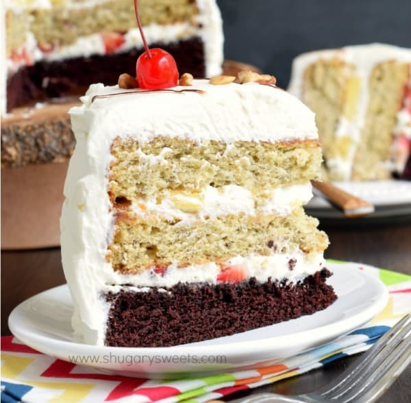 Banana Split Cake: layers of chocolate cake, banana cake, fresh fruit and whipped cream frosting for an ultimate, decadent cake recipe!