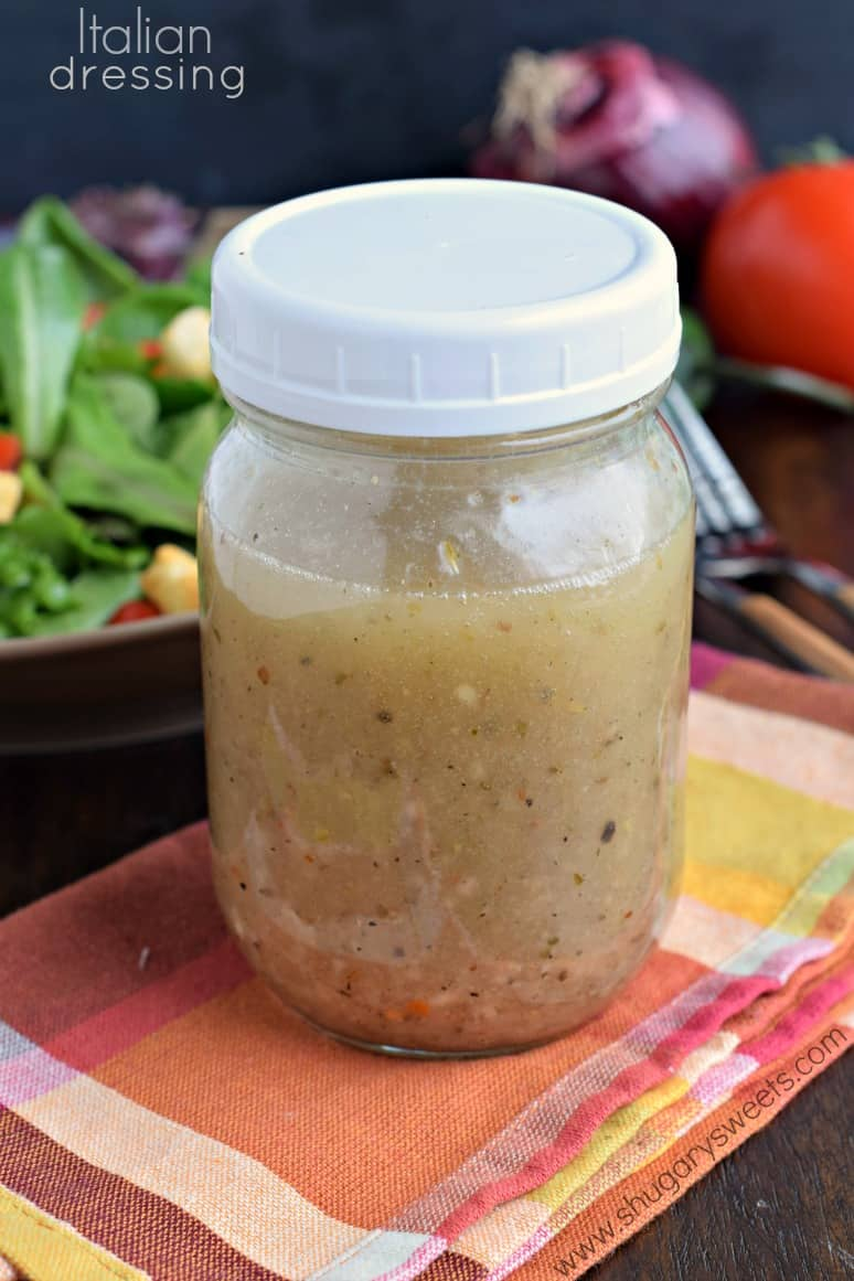 Italian dressing in a mason jar with a white lid.