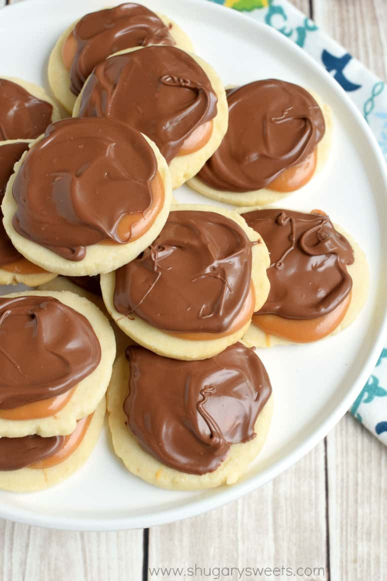 White serving plate with stacks of Twix cookies on top.