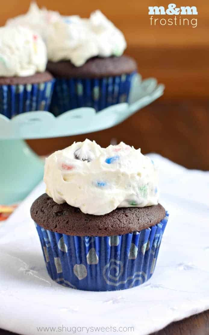 Fluffy vanilla frosting packed with m&m candies, on top of a from scratch chocolate cupcake!