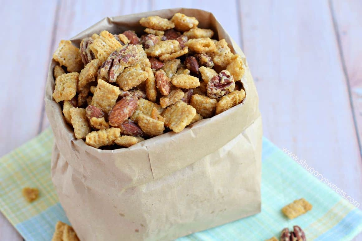 Caramel snack mix with nuts in a paper bag.