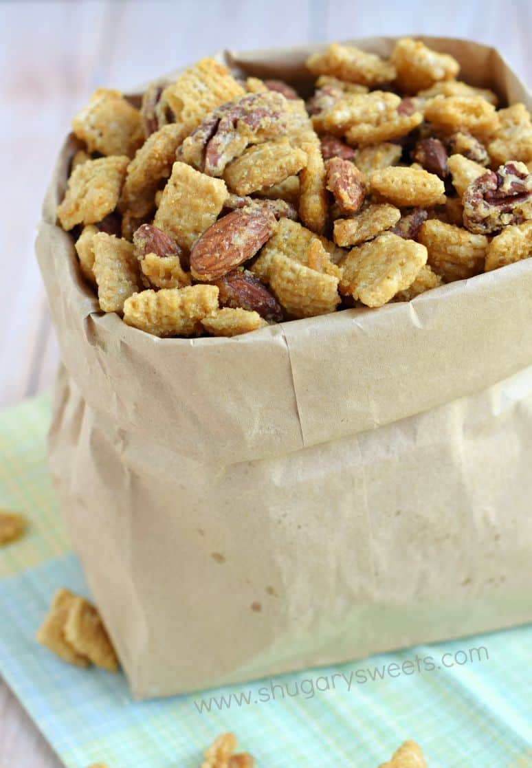 Caramel and nut snack mix in a paper bag.