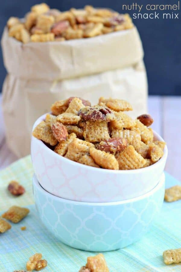 Nutty caramel snack mix in a stack of bowls.