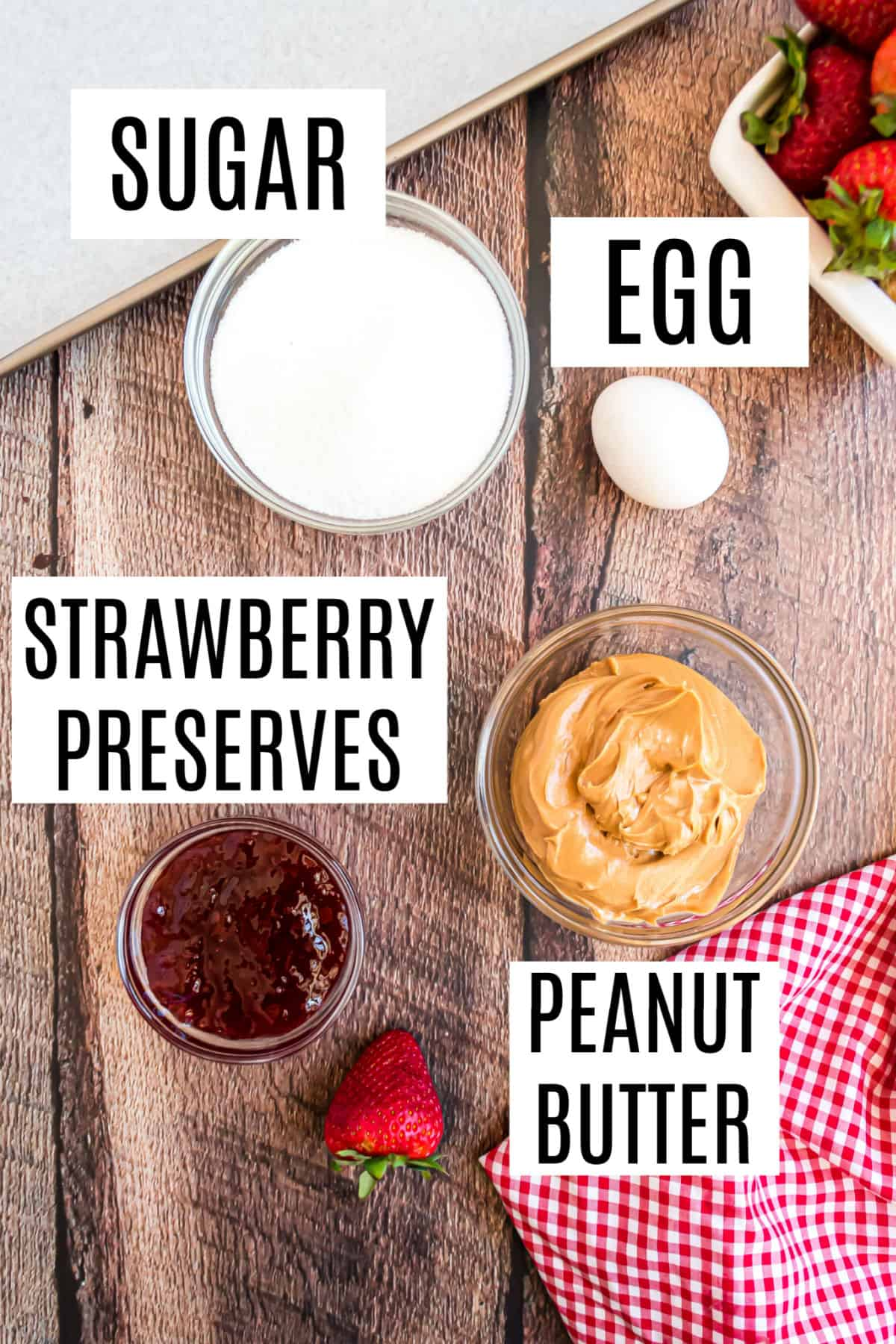 Ingredients needed for peanut butter and jelly cookies.